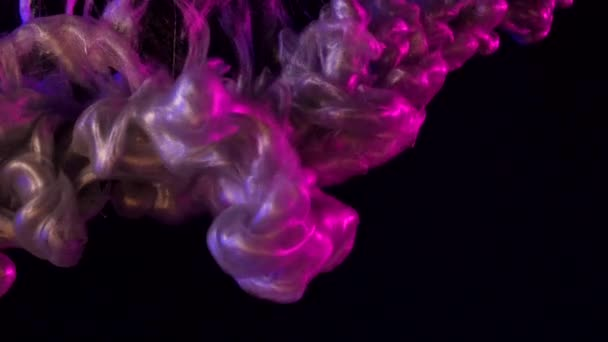 Amazing silky shining mixed paints of pink, silver, blue. Glitter ink in water shooting with high speed camera, Dropped, reacting, creating abstract cloud formations and metamorphosis on black. Smoke