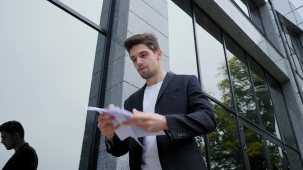 Angry furious male office worker throwing crumpled paper, having nervous breakdown at work, screaming in anger, stress management, mental distress problems, losing temper, reaction on failure.