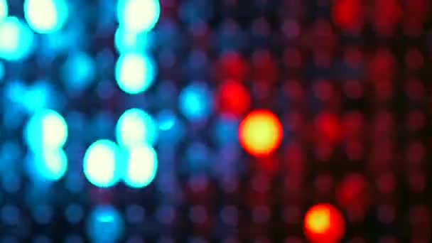 Red and blue sequins sparkling reflective background. Abstract kinetic glitter wall moving. Night club decoration. Can be used as transitions, added to modern projects,art backgrounds.