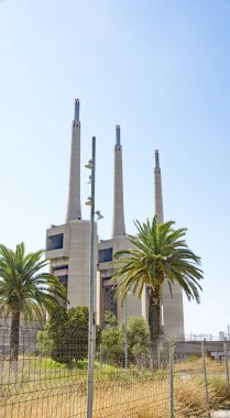 Three chimneys of the old thermal power station of Besos, Sant Adria del Besos; 12:25 p.m .; July 20, 2015; Barcelona, Catalunya, Spain, Europe