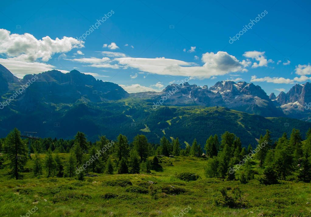 Mountain landscape with crests and fir trees - in a summer day