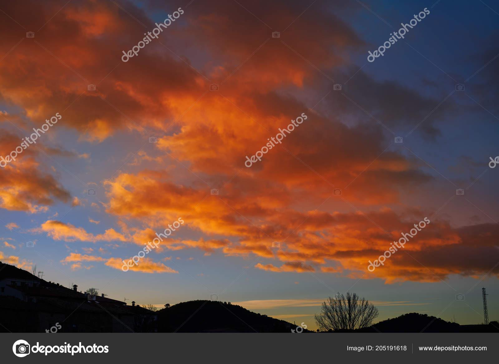 Sunset Mountain Silhouette Orange Clouds Blue Sky Stock
