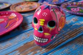 Fotografie Mexican pink skull dia muertos crafts in Mexico of deaths day