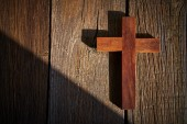 Fotografie Christian cross on wood over wooden background vintage with shadows