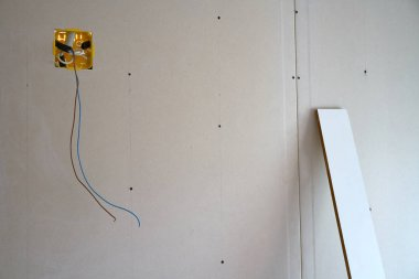 laminated plasterboard wall construction with electric box