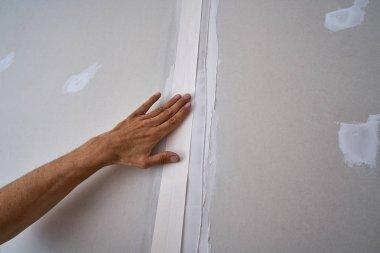 laminated plasterboard plastering join tape DIY detail