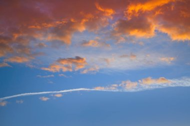 Sunset sky clouds orange and blue colors