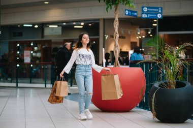 "Картина, постер, плакат, фотообои ""retail, gesture and sale concept - smiling teenage girl with many shopping bags at mall"", артикул 255854718"