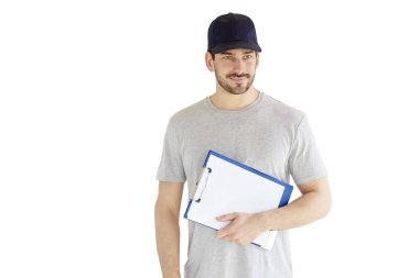 Portrait of young construction worker holding clipboard in his hand while standing at isolated white background.