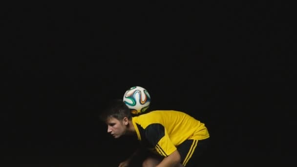 the footballer catches the ball