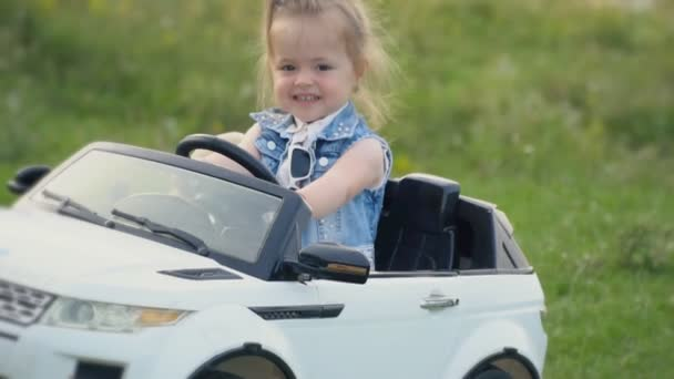 the little girl is driving a car