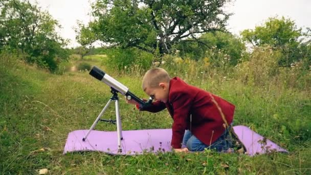 boy with a telescope in nature