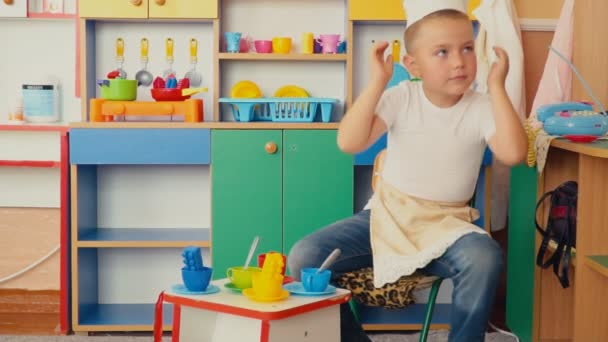 the little boy is playing what is cooking