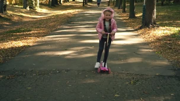 the girl is riding a scooter