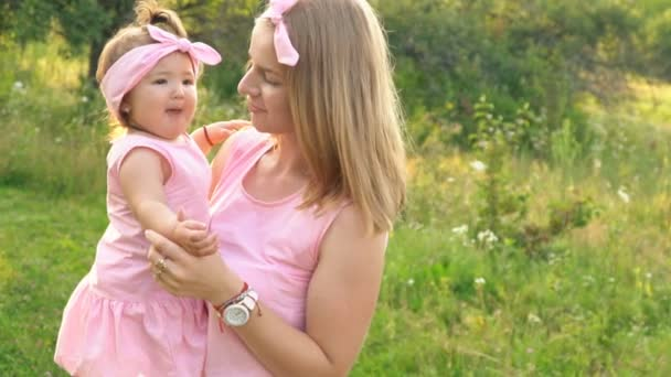 Mom and daughter in identical dresses