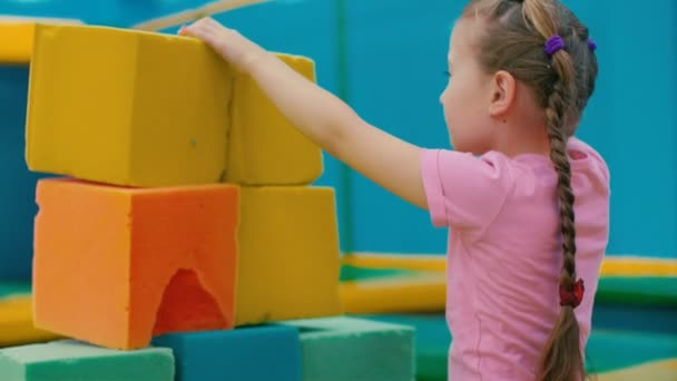 girl playing with soft cubes