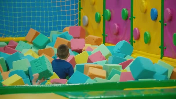 children play with soft cubes