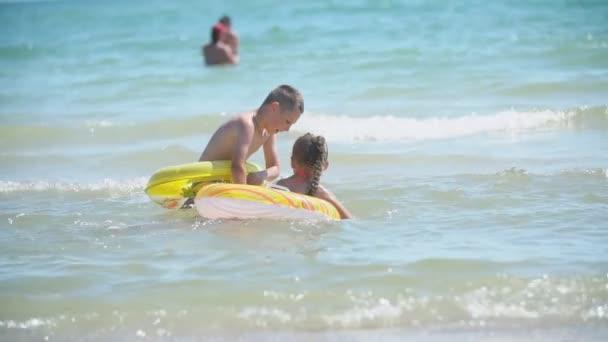 children swim in the sea