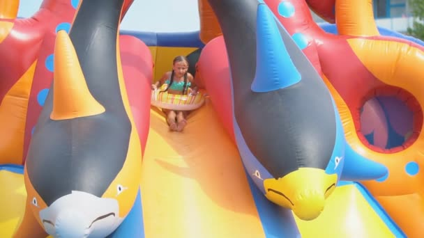 girl goes downhill in a water park
