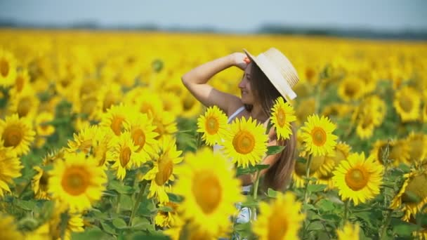 girl in a hat on a background of sunflower flowers