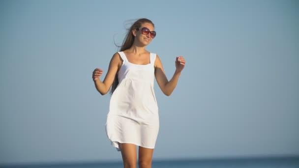 woman in white dress near the sea