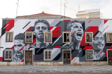 PORTIMAO, PORTUGAL: 20th MAY 2018 - Graffiti painting of several celebrities including Cristiano Ronaldo soccer player.
