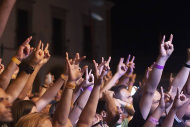 Close up view of hands up on concert festival.