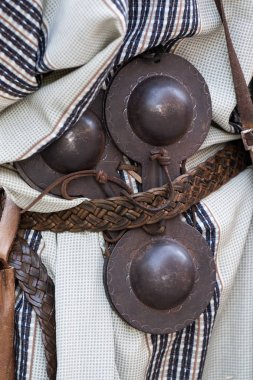 Close up view of a man with medieval hand castanets.