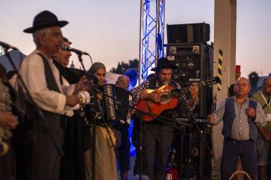 LAGOA, PORTUGAL - 18th AUGUST, 2018 - Alentejo singers and players on a rural fair perform traditional songs on the local fair of Fatacil, Lagoa, Portugal.