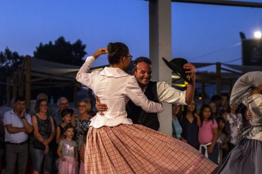 LAGOA, PORTUGAL - 18th AUGUST, 2018 - Local traditional dancers on a exhibit fair of agriculture, commerce, gastronomy, music, rustic artisans, traditional art and crafts located in Lagoa, Portugal.