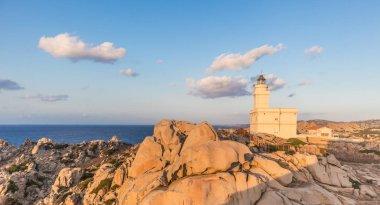 Lighthouse on granite rock formations at Capo Testa, Sardinia, Italy.
