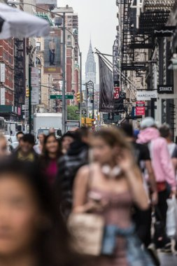 New York, NY, USA - May 17, 2018: Crowds of people walking sidewalk of Broadway avenue in Soho of Midtown Manhattan on may 17th, 2018 in New York City, USA.