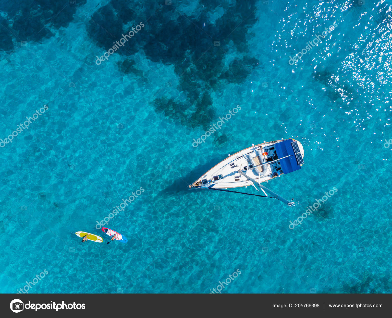 Aerial View To Yacht In Deep Blue Sea Drone Photography Stock Photo