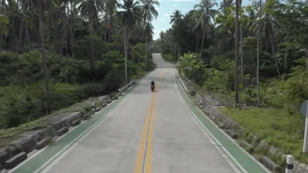 3 flat aerial shots in cinelike-D. Biker riding motorcycle by the road
