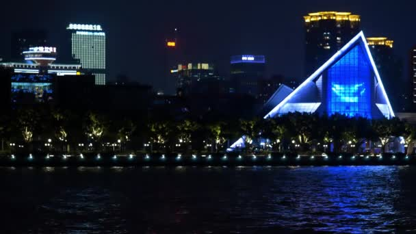 Seafront in the modern night city in blue lights