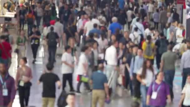 Defocused people crowd moving in airport terminal