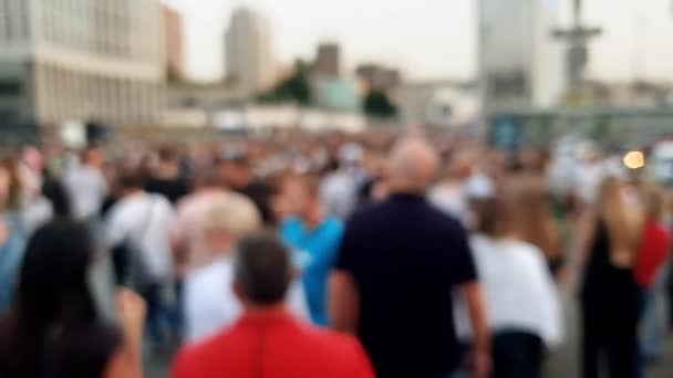 4k out of focus video of big crowd of people walking on street at evening