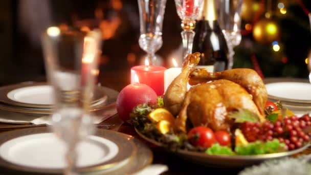 Closeup 4k video of tasty hot freshly baked chicken on big ornate plate. Dining table served for big family on winter holidays and celebrations.