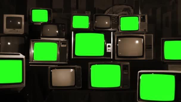 Számos TV-vel, zöld képernyők. Szépia tónusú. A 80-as években az esztétika. Készen áll a helyére zöld képernyők minden felvétel, vagy a kép ön akar. Full Hd.