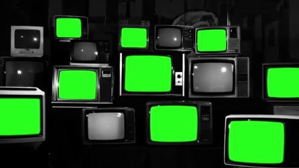 Számos TV-vel, zöld képernyők. Fekete-fehér hang. A 80-as években az esztétika. Készen áll a helyére zöld képernyők minden felvétel, vagy a kép ön akar. Full Hd.