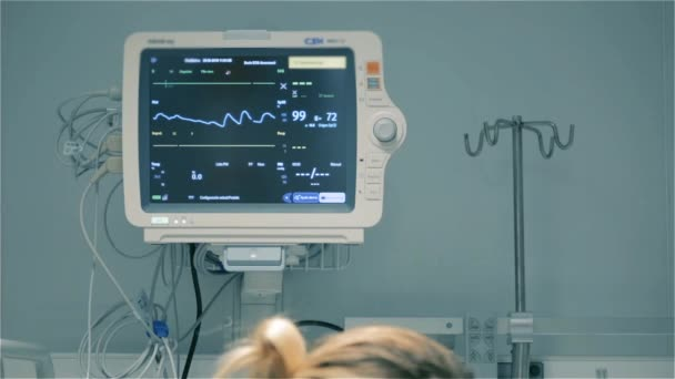 Medical Exam. Female Doctor Monitoring Patient Condition. Cardiogram Pulse. Heart Beat Monitoring. EKG Heart Monitor. Full HD.