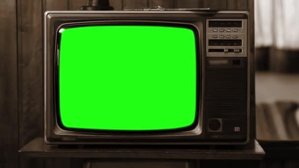 Vintage Tv zöld képernyő. A 80-as években az esztétika. Szépia tónusú. Kicsinyítés. Kész arra, hogy cserélje ki a zöld képernyő felvétel vagy képet szeretne. Full Hd.