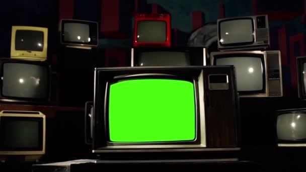 Vintage Tv Green Screen s mnoha 1980s Tvs. připravenou fabion nahradit záběry nebo obrázek chcete. Můžete to udělat s efektem klíčování (Chroma Key) v aplikaci Adobe After Effects.