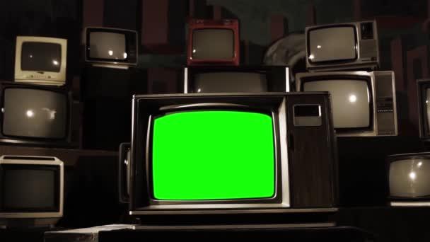 Mnoho televizorů s zelenou obrazovkou zapnutí. Sépiový tón. Estetika na 80. Připraven k nahrazení Green Screen s Any záběry nebo obrázek chcete. Full Hd.