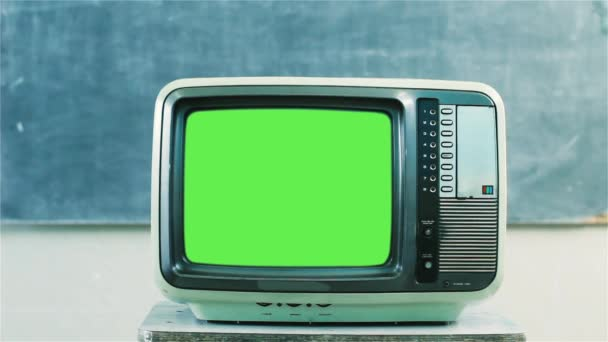 80s Television with Green Screen in a School. Dolly Out. Close-Up. Ready to Replace Green Screen with Any Footage or Picture You Want. You can do it with Keying (Chroma Key) effect in Adobe After Effects or other video editing software. Full HD.