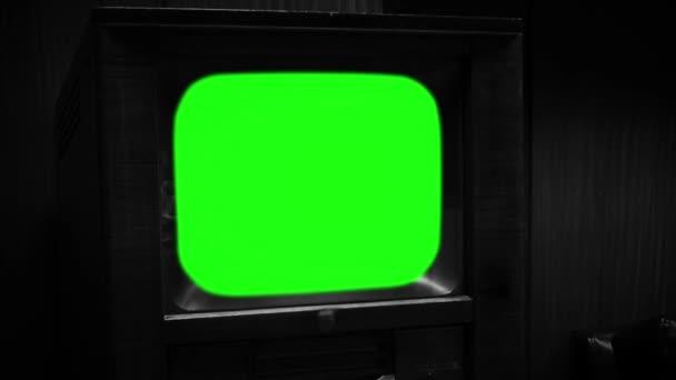Vintage televízió zöld képernyő. Fekete-fehér színű.