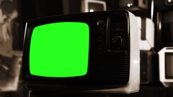 Régi Tv zöld képernyő-val sok TV-vel felszerelt szépia hangot.