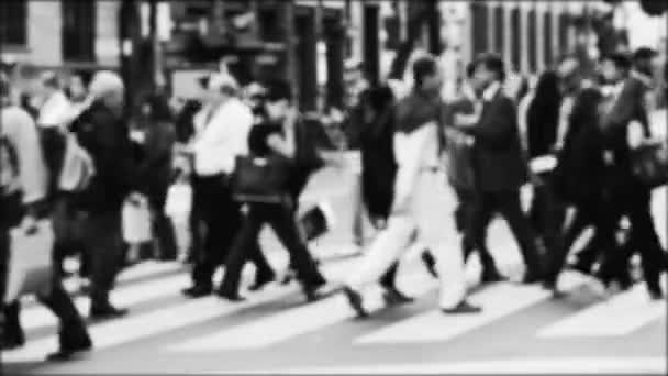 People Out Of Focus Crossing The Avenue By The Pedestrian Path. Black And White.