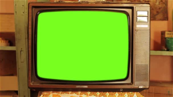 80S Television With Green Screen. Aesthetics Of The 80S. You can replace green screen with the footage or picture you want. You can do it with Keying effect in After Effects  (check out tutorials on YouTube).