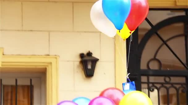Helium Balloons Flying  with Present to a Girlfriend. Declaration Of Love On The Street.
